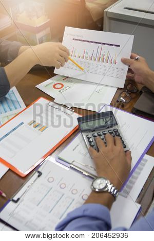 Business And Finance Concept Of Office Working, Businessmen Discussing Expense Trends Analysis Chart