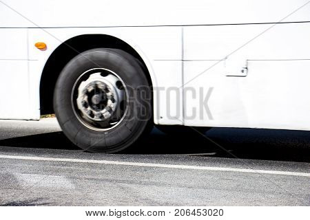 bus wheel driving on the main road at high speed