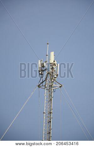 close up telecom tower pole on blue sky