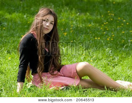 Girl Sitting In Th Park