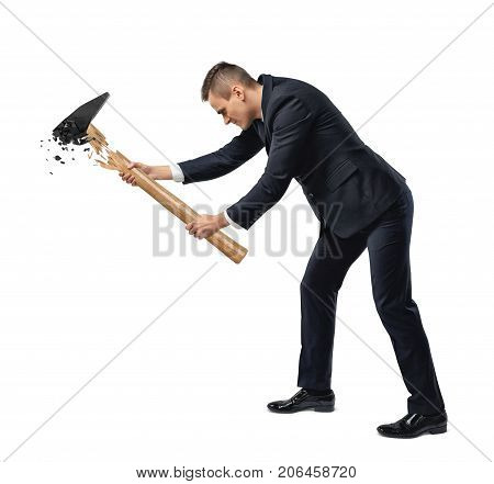 A businessman on white background raises a large hammer with a metal head and a wooden handle both broken. Heavy work. Office dreadful routine. Breaking from boring job.