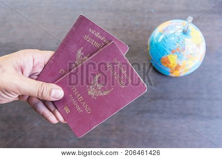travel and business accessories concept.Passport travel concept.Passport on wood