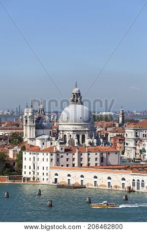 VENICE ITALY - SEPTEMBER 21 2017: Baroque church Santa Maria della Salute sea view. It was built in the 17th century as a votive thanksgiving after the plague epidemic