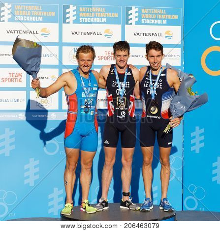 STOCKHOLM - AUG 26 2017: Jonathan Brownlee Kristian Blummenfelt and Pierre le Corre on the winner's stand in the Men's ITU World Triathlon series event Augist 26 2017 in Stockholm Sweden