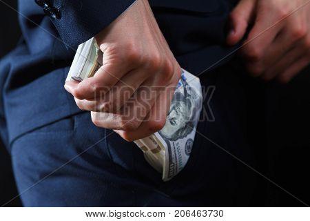 Concept for corruption bankruptcy bail crime bribing fraud auction bidding Bundle of dollar cash in hand