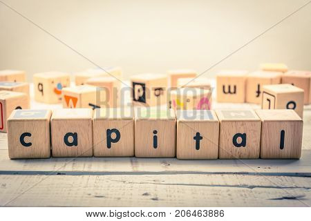 Word ' capital ' wood Cubic on the wood