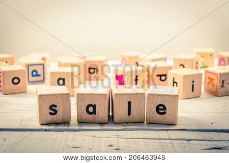 Word ' sale ' wood Cubic on the wood