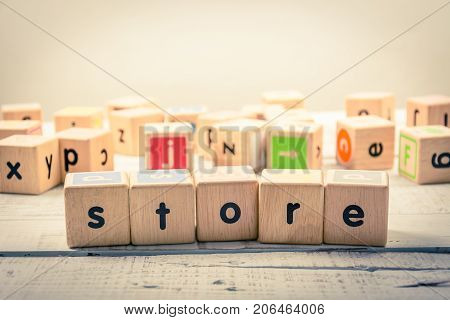 Word ' store ' wood Cubic on the wood