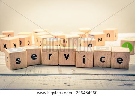 Word ' service ' wood Cubic on the wood