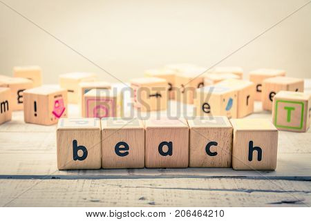 Word ' beach' wood Cubic on the wood