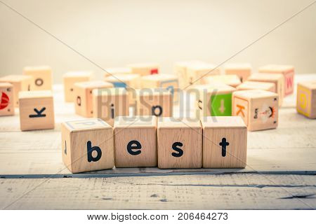 Word ' best ' wood Cubic on the wood