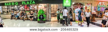 BANGKOK THAILAND - AUGUST 12: Customers queue for tables at Bar-B-Q Plaza Restaurant for dinner on August 12 2017 in Bangkok. August 12 is Mother's day as well as the Queen's birthday in Thailand.