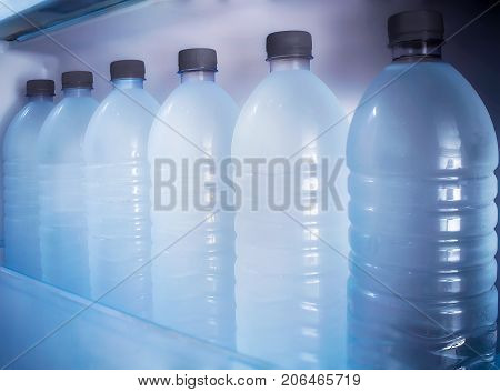 Fresh and Chilled Bottles of Drinking Water in the Fridge