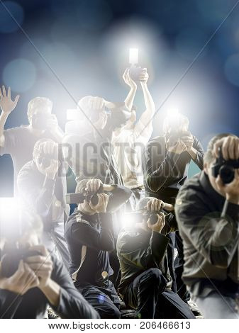 Crowd of paparazzi flashing in front a dark blue background.