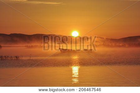 lake evaporation and fishing boat & lake sunrise