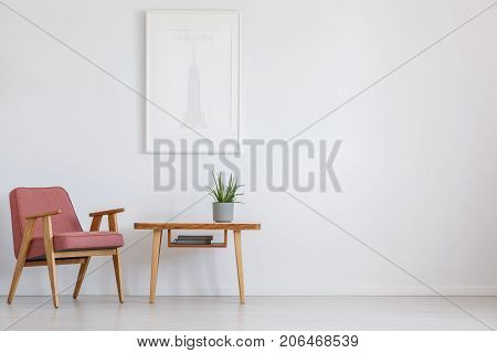 Pink Chair Next To Table