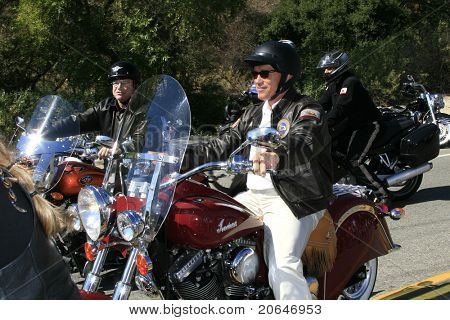 TRABUCO CANYON, CA - OCT 21: Governor Arnold Schwarzenegger with actor Tom Arnold to campaign at a biker rally held in support of U.S. troops & their families, in Trabuco Canyon, CA on October 21, 2006.