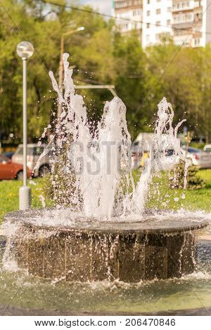 City fountain in European style in the summer hot noon