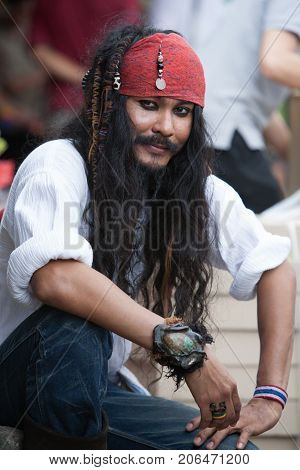BANGKOK THAILAND - DECEMBER 22 2007 : The Chatuchak Weekend Market is the largest market in Thailand. A seller disguised as a Pirate jack sparrow