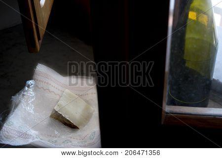 sardinian pecorino illumined from light of a window