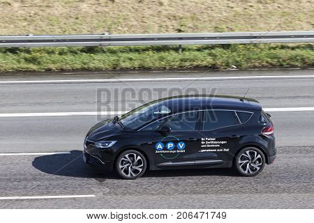 Frankfurt Germany - Sep 19 2017: Small french family van Renault Scenic fourth generation driving on the highway in Germany