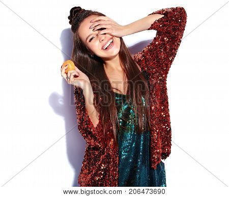 Beautiful caucasian smiling hipster brunette woman model in bright shinny reflecting summer stylish jacket and green dress isolated on white background. Eating french macaroon