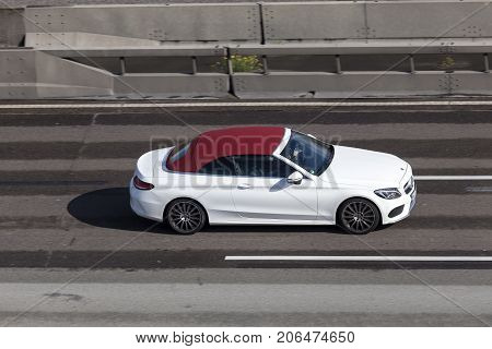 Frankfurt Germany - Sep 19 2017: Luxury white Mercedes Benz C-Class Cabriolet driving on the highway in Germany
