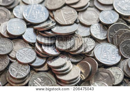 Low denomination British currency with five, ten and twenty pence coins in full frame.
