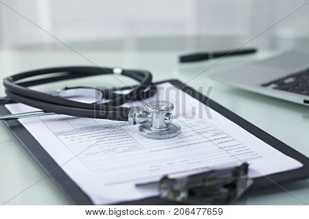 Medicine doctor's working table. Focus on stethoscope .