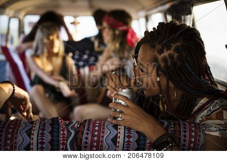 Friends Drinking Alcohol Beers Together on Road Trip Journey