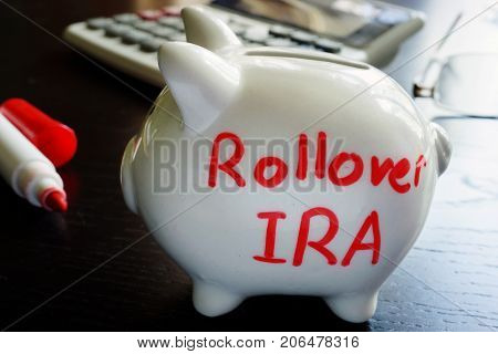 Rollover IRA written on a piggy bank.