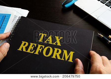 Tax reform on an office desk and notebook.