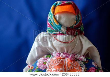 old-fashioned doll hand made Russian folk doll for carnival