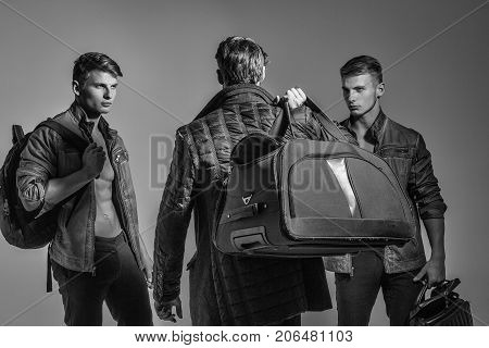 Guys Or Photographer Holds Photo Camera And Bags