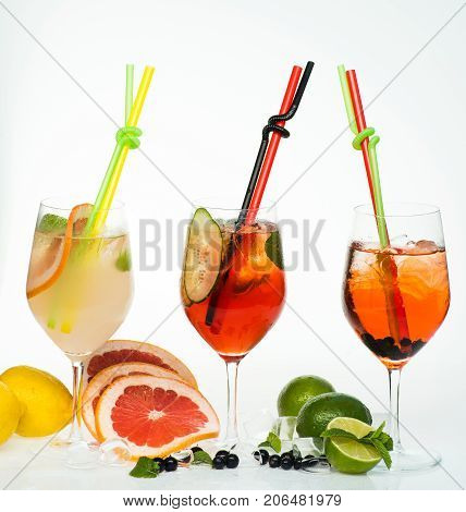 Party and summer vacation. Drink and food. Alcoholic beverage and fruit at restaurant. Fruit slice and cocktail glass at bar. Cocktails isolated on white.