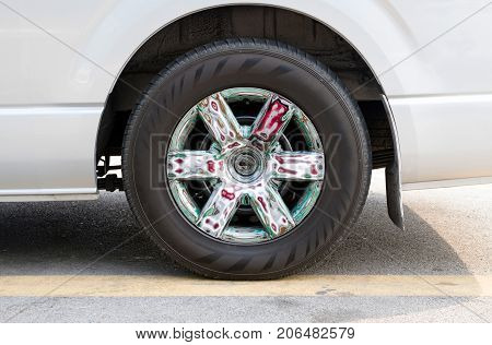white car with colorful of alloy wheels