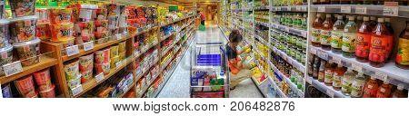 BANGKOK THAILAND - SEPTEMBER 01: An unidentified woman shops in Foodland Supermarket on September 01 2017 in Bangkok.