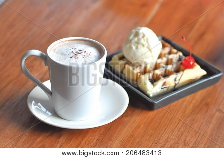 hot cappuccino or hot coffee and waffle