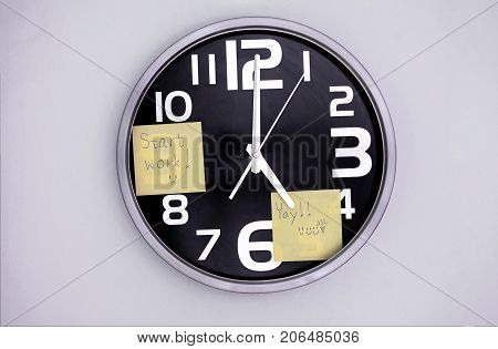 Wall Clock in a Office with a Note Over Nine and Five