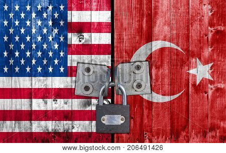 US and Turkey flag on door with padlock