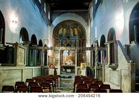 Rome Italy - October 31 2012: Interior view of church of Santa Maria in Cosmedin. The Mouth of Truth is a marble mask in Rome Italy which stands against the left wall of the portico of the church