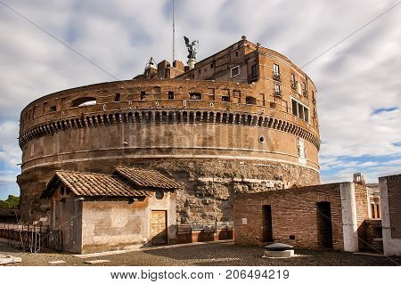 The Mausoleum of Hadrian usually known as the Castel Sant'Angelo is a towering cylindrical building in Parco Adriano Rome Italy