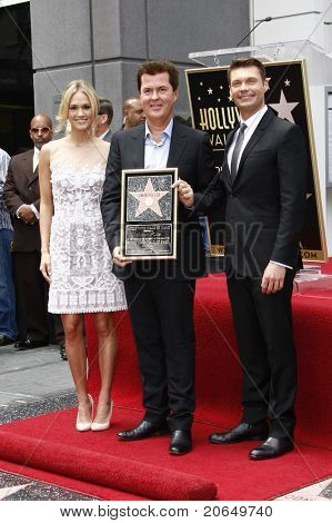 LOS ANGELES - MAY 23: Carrie Underwood, Simon Fuller, Ryan Seacrest at a ceremony where Simon Fuller receives a star on the Hollywood Walk of Fame in Los Angeles, California on May 23, 2011.