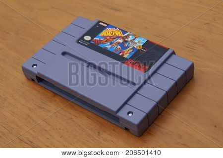 Almere, The Netherlands - September 29, 2017: Super Nintendo Entertainment System (SNES) game cartridge of NCAA Basketball.