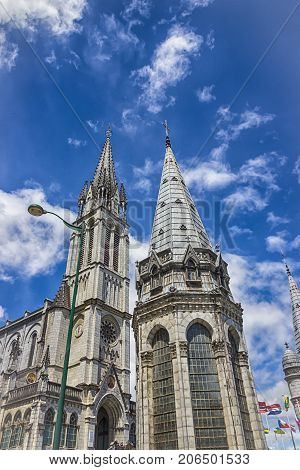 Basilica of our Lady of the Rosary and cloudy blue sky. Lourdes, France