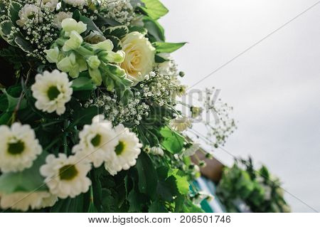 Happy outdoor Wedding Ceremony Scene for a summer mountain wedding. Wedding aisle, decorated wedding alter and flower decorations with mountains in the background.