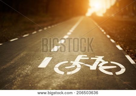 low angle bike lane sign on cycleway at sunset