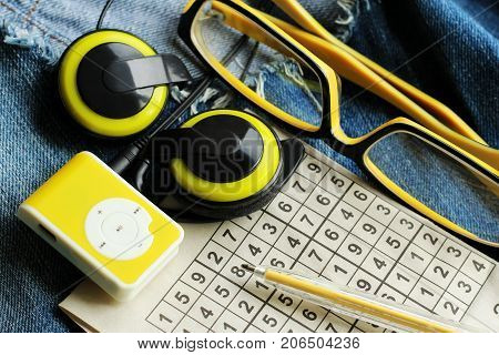 Yellow music player and beautiful overhead headphones lux