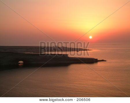 Sunrise On A Rocky Beach