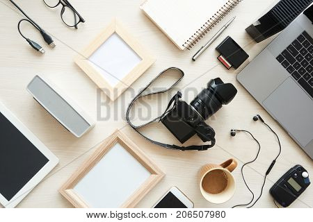 Digital, card reader and empty frames on table of photographer
